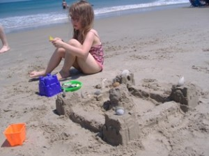 Katie and her sandcastle